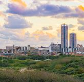 Popular and touristic location Scheveningen The netherlands a town near the beach at sunset view from the dunes on the buildings. A Popular and touristic stock photography