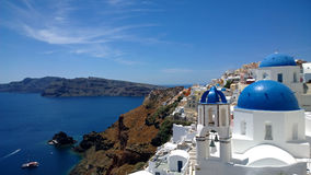 The popular town of Oia in Santorini - the top view on the beach, white houses and blue roofs Royalty Free Stock Images