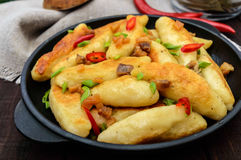 Popular traditional Czech, Hungarian, German dish: potato knedli dumplings with slices of fried bacon Royalty Free Stock Photos