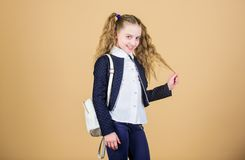 Popular useful fashion accessory. Schoolgirl with small leather backpack. Carry bag comfortable. Stylish mini backpack. Learn how fit backpack correctly. Girl stock images