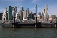 Fulton Ferry Landing, Brooklyn New York, USA. A popular waterfront destination for tourists,this venue offers access to the East River Ferry, Barge Music, a beer royalty free stock photos