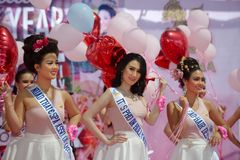 Beauty Pageant. Popularity contest, part of the beauty pageant, is determine by number of balloons given to contestants from fans. Pageant took place during the Stock Photos