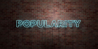POPULARITY - fluorescent Neon tube Sign on brickwork - Front view - 3D rendered royalty free stock picture Stock Image