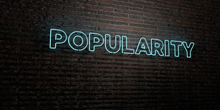 POPULARITY -Realistic Neon Sign on Brick Wall background - 3D rendered royalty free stock image Royalty Free Stock Images