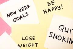 Popularni nowy rok cele, postanowienia na kolorowym kleistym pustym miejscu n lub Obraz Stock