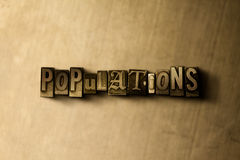 POPULATIONS - close-up of grungy vintage typeset word on metal backdrop Royalty Free Stock Photo
