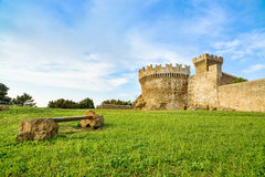 Populonia medieval village landmark, bench, city walls and tower. Tuscany, Italy. Royalty Free Stock Photos