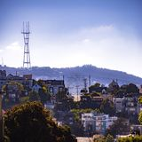 The populous San Francisco City on a sunny day. View of the populous city of San Francisco with trees, buildings and houses. Utility poles and electric cables stock photography