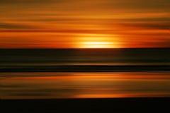 Por do sol abstrato na praia Imagem de Stock