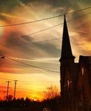 Por do sol acima da igreja fotografia de stock royalty free