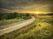 Por do sol acima dos montes Imagem de Stock Royalty Free