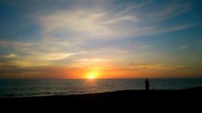 Por do sol acima do mar fotos de stock royalty free