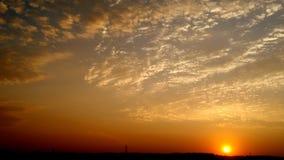 Por do sol alaranjado Imagens de Stock