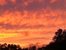 Por do sol alaranjado da nuvem Imagem de Stock Royalty Free