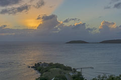 Por do sol alaranjado de irradiação Imagem de Stock Royalty Free