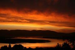 Por do sol alaranjado do céu Fotos de Stock Royalty Free