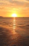 Por do sol alaranjado do mar Imagens de Stock Royalty Free