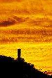 Por do sol ardente Imagem de Stock