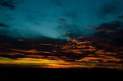 Por do sol atrás do horizonte Fotografia de Stock Royalty Free