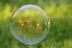 Por do sol através de uma bolha Imagem de Stock Royalty Free