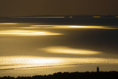 Por do sol bonito em um beira-mar Fotos de Stock
