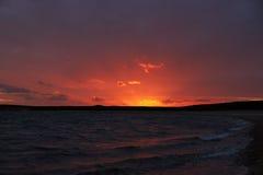 Por do sol colorido na praia de Kaas em Dinamarca Imagem de Stock Royalty Free