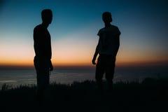Por do sol com do mar a noite quase Imagem de Stock
