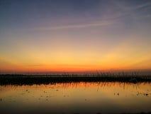 Por do sol com reservatório Imagem de Stock Royalty Free