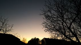 Por do sol da cidade do inverno fotos de stock royalty free
