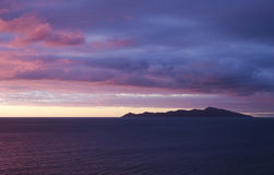 Por do sol da ilha de Kapiti Fotografia de Stock Royalty Free