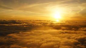 Por do sol da janela do avião Imagem de Stock