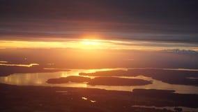 Por do sol da janela do avião Imagens de Stock