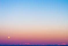 Por do sol da Lua cheia em Japão Fotografia de Stock