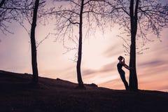 Por do sol da menina Imagem de Stock