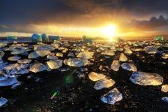 Por do sol da obscuridade do gelo da praia Foto de Stock Royalty Free