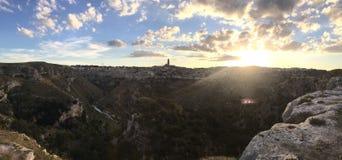 Por do sol da paisagem de Matera Foto de Stock