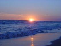Por do sol da praia Imagens de Stock