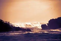 Por do sol da praia da tempestade Foto de Stock