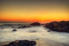 Por do sol da praia de África do Sul Capetown Imagens de Stock Royalty Free