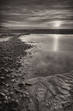 Por do sol da praia de Galês Foto de Stock Royalty Free