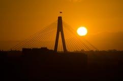 Por do sol da silhueta da ponte de Anzac Imagem de Stock Royalty Free