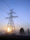 Por do sol de alta tensão da torre Fotografia de Stock Royalty Free