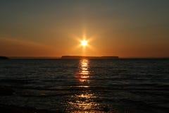Por do sol de ardência Fotografia de Stock