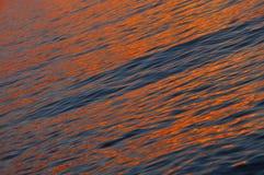 Por do sol de brilho da cor alaranjada Imagem de Stock