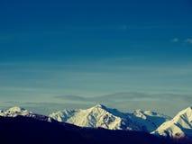 Por do sol de Glourios nos alpes Fotografia de Stock Royalty Free