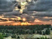 Por do sol de HDR sobre a floresta Fotografia de Stock Royalty Free