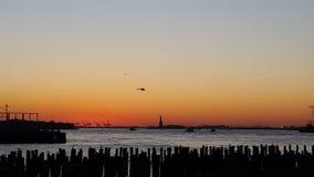 Por do sol de New York imagens de stock