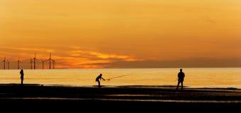 Por do sol de pesca ido Imagens de Stock