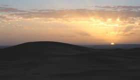 Por do sol de Sahara Foto de Stock Royalty Free