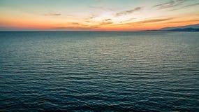 Por do sol de um ` s do pássaro Fotos de Stock Royalty Free